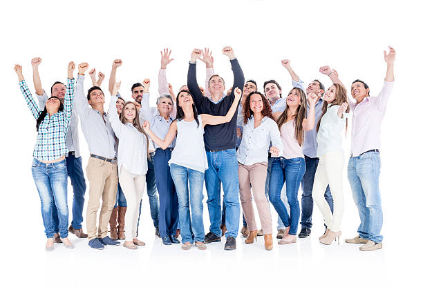 Large group of Latin American people celebrating a victory with arms up - isolated over white background